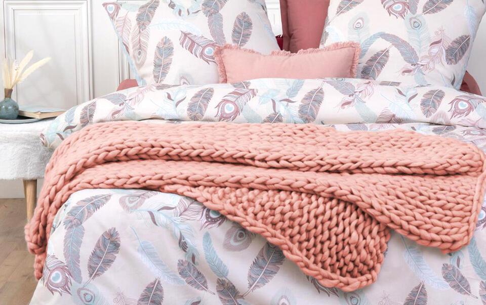manta rosa de punto grueso